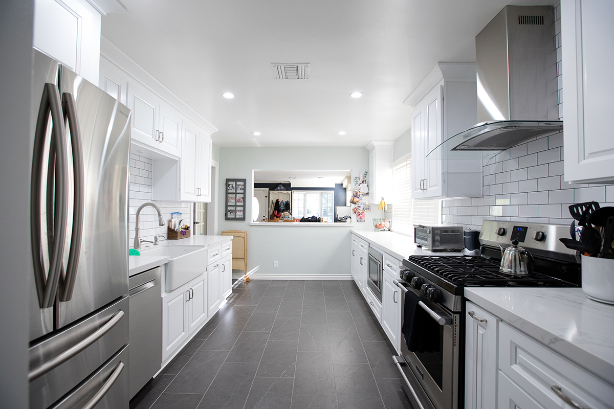 Kitchen Remodeling Galley Style with White Shaker and Subway Backsplash in Sherman Oaks CA